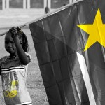 Girl with Sudanese flag